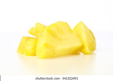 Closeup Pineapple chunks on white background