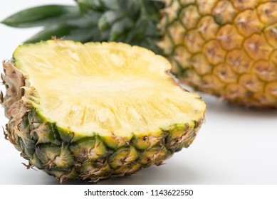 Close-up pineapple slice isolated on white background
