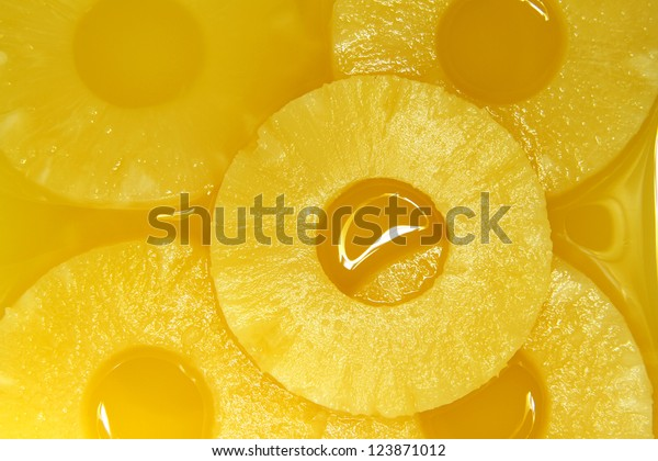 Closeup of pineapple slices in natural juice