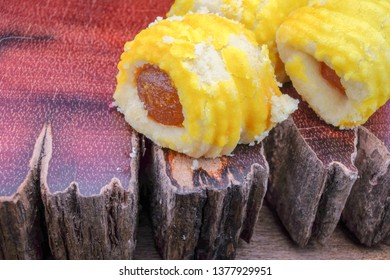 Closeup of a pineapple tart on rustic wood.