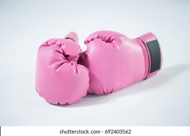 Close-up of pink boxing gloves on white background
