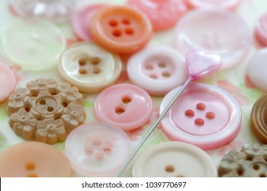 Closeup of Pink Buttons and Decorative Pin
