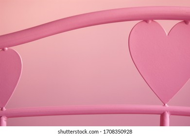 Closeup of a pink loveheart bed frame