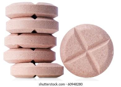 closeup of pink pills on white