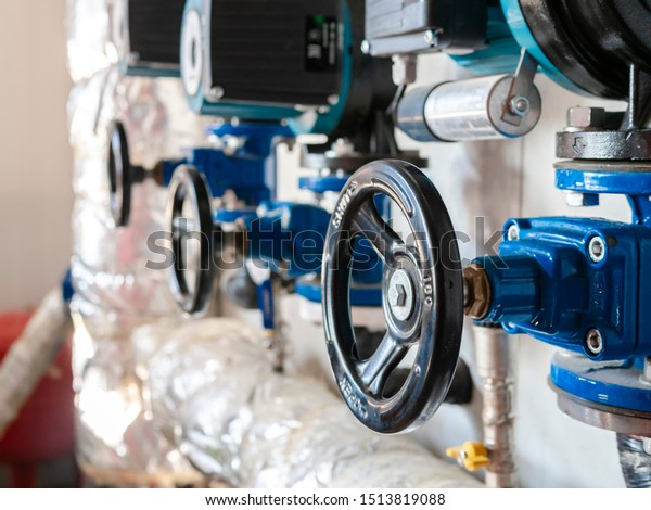 Closeup of pipes and faucet valves of hvac system