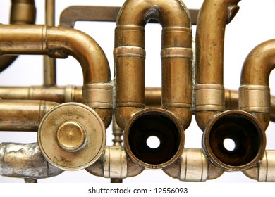 Close-up of pipes and tubes in old damaged trumpet