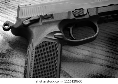 Closeup of pistol handgun trigger for shooting self defense or military