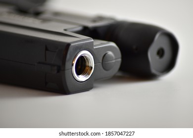 close-up of a pistol on a white background