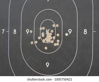 Closeup of pistol target, for handgun Service discipline, showing good shooting accuracy in a competition