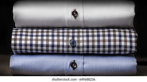 Close-up of Plaid Folded Men's Shirts