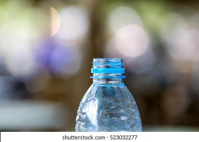 Close-up plastic bottle with bokeh background