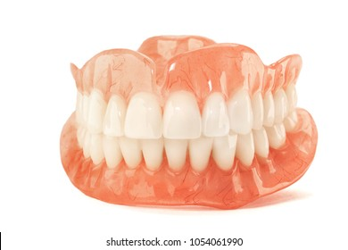 Close-up of plastic denture teeth isolate no fond background. New technologies in modern dentists.