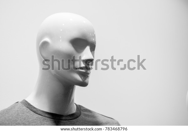 Close-up of a plastic mannequin head. Black and white