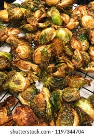 Close-up of a plate of golden brown deep fried brussels sprouts.