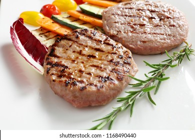 Close-up of a plate of meat burgers. Concept of: Italian cuisine, gourmet.