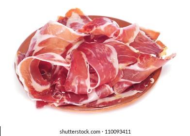 closeup of a plate with spanish serrano ham served as tapas