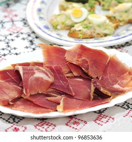 closeup a plate with spanish serrano ham and other tapas