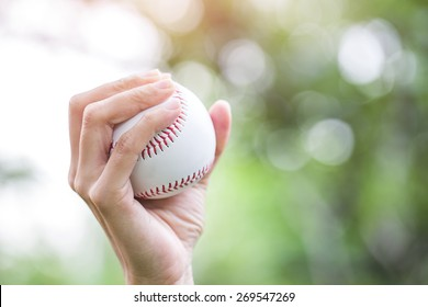 Close-up of player's hand holding baseball