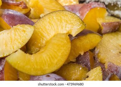 Closeup of plum slices with sugar