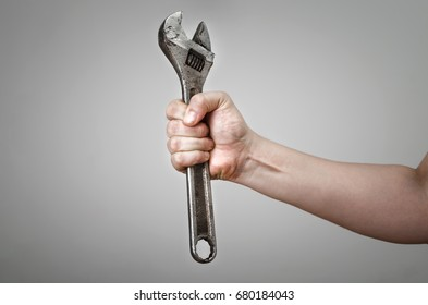 Close-up of plumber hand with wrench. Concept of repair and technical assistance.