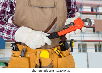Close-up Of Plumber Holding Monkey Spanner With Worktool In Tool Bag
