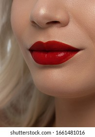 Closeup plump Lips. Lip Care, Fillers. Macro photo with Face detail. Natural shape with perfect contour. Close-up perfect natural lip makeup beautiful female mouth. Plump sexy full red lips