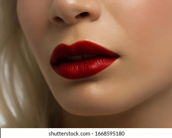 Closeup plump Lips. Lip Care, Augmentation, Fillers. Macro photo with Face detail. Natural shape with perfect contour. Close-up perfect lip makeup beautiful female mouth. Plump sexy full red lips
