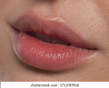 Closeup plump Lips. Lip Care, Augmentation, Fillers. Macro photo with Face detail. Natural shape with perfect contour. Close-up perfect natural lip makeup beautiful female mouth. Plump sexy full lips