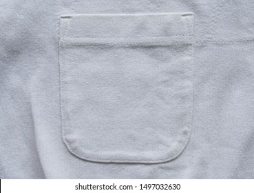 closeup pocket on white cotton shirt