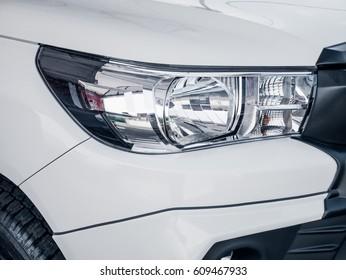 Closeup point on Headlight lamp car.