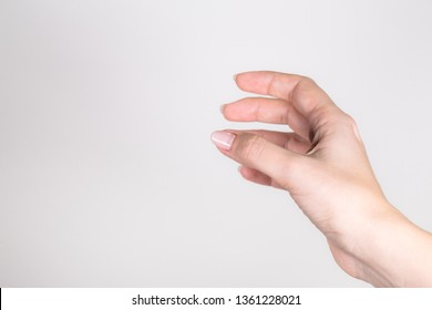 Closeup point of view outstretched female single hand of woman isolated on grey background. Horizontal color photography.