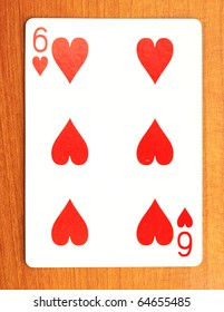 closeup of poker cards on a wooden background