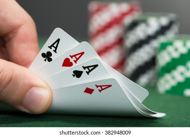 Close-up Of A Poker Player Playing Cards