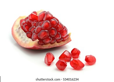 Closeup of pomegranate Seeds on a white background