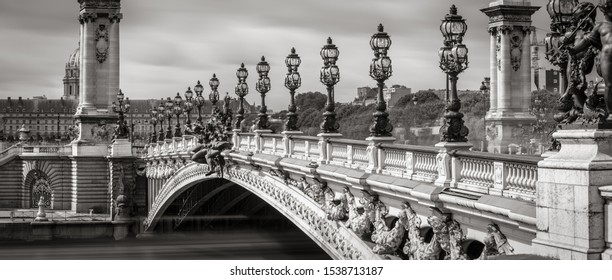 Close-up of Pont Alexandre III Bridge with its candelabras and lamp posts in Black & White. Paris, France, 7th Arrondissement
