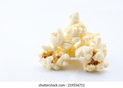 Closeup of popcorn on white background