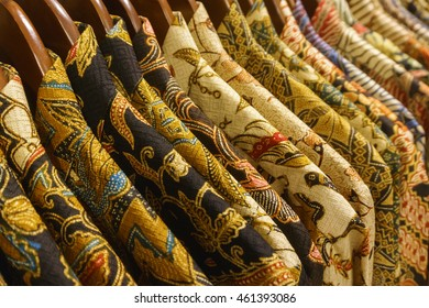 Close-up of popular costume in Indonesia called Batik with beautiful colours hung up for sale.