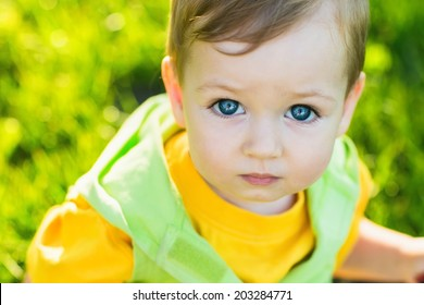 Closeup portrait of adorable blue-eyed baby looking at camera