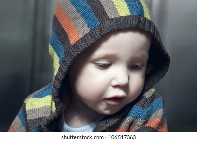 Closeup portrait of adorable child in hood.