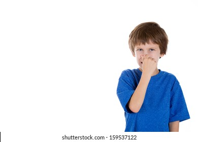 Closeup portrait of adorable kid pinching nose together because something stinks, isolated on white background with copy space