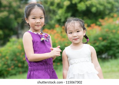 Close-up portrait of adorable little girls of Asian appearance