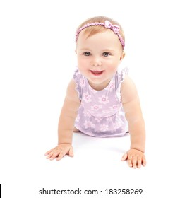 Closeup portrait of adorable sweet child crawling in the studio isolated on white background, playful little girl, happy childhood concept