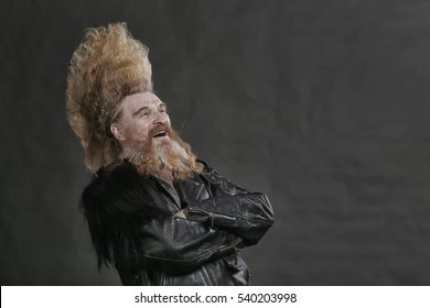 closeup portrait adult biker in black leather jackets and high mohawk and beard