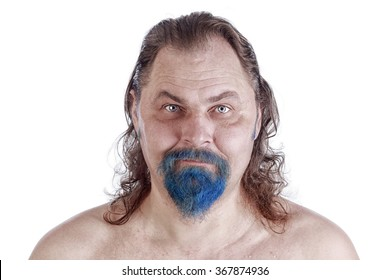 close-up portrait of an adult male with long hair, blue beard and naked torso on white background studio