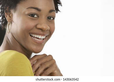 Closeup portrait of African American woman smiling isolated on white background