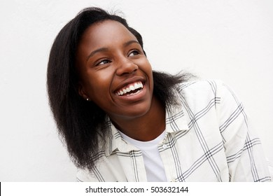 Closeup portrait of african woman looking away laughing.