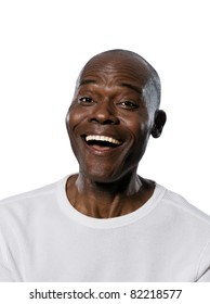Close-up portrait of an afro American laughing man in studio on white isolated background