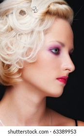 close-up portrait of alluring blonde with hairdo