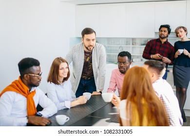 closeup portrait of ambitious group of business People chatting together in the kitchen of office