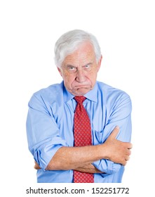 Closeup portrait of an angry, mad, annoyed senior businessman, isolated on white background . Human emotions and interpersonal conflict resolution.